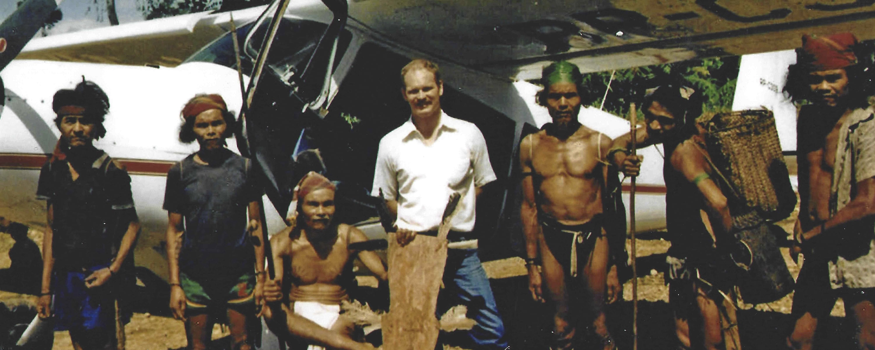 Martin Burnham, a jungle pilot, posing for a photo with the Tribes people