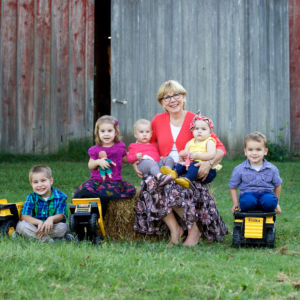 Gracia Burnham poses for a photo with all of her grandkids