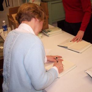 "Gracia Burnham signing copies of her book ""In the Presence of My Enemies"""